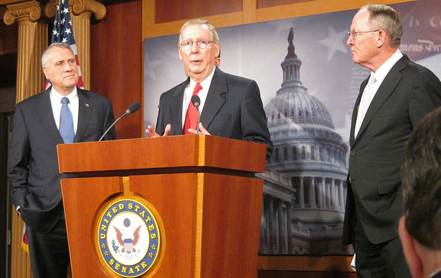 Photo credit: Talk Radio News Service via Photopin CC, Senate Minority Leader Mitch McConnell (R-Ky.) outlines a new plan to raise the nation's debt limit. Sens. Jon Kyl (left) and Lamar Alexander (right) look on.