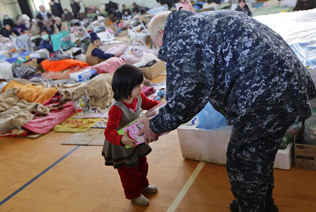 Photo credit: DVIDSHUB via Photopin, CC Navy Adm. Robert F. Willard, commander of U.S. Pacific Command, gives a toy to a child while touring a shelter facility in Ishinomaki city, Miyagi Prefecture, Japan, March 23. Willard and John V. Roos, U.S. ambassador to Japan, assisted in the delivery of relief supplies to displaced citizens. Since March 12, Marines and sailors have delivered food, fuel, water and supplies to disaster-stricken areas near Sendai as part of Operation Tomodachi. (Photo by: Lance Cpl. Steve Acuff) III Marine Expeditionary Force Public Affairs Photo by Cpl. Justin Wheeler Date Taken:03.23.2011 Location:WATARIHA ELEMENTARY SCHOOL, MIYAGI, JP