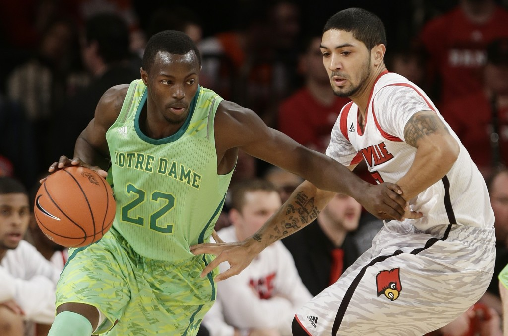 Notre Dame's Jerian Grant (22) is defended by Louisville's Peyton Siva (3) during a game at the Big East Conference tournament on March 15, in New York. (Frank Franklin II, AP)