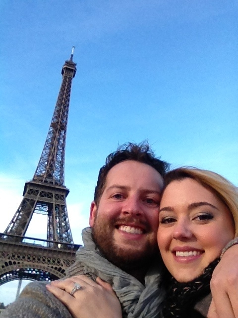 Tyler Barnett and Jenna Watson stand near the Eiffel Tower in Paris after their engagement. (Jenna Watson)