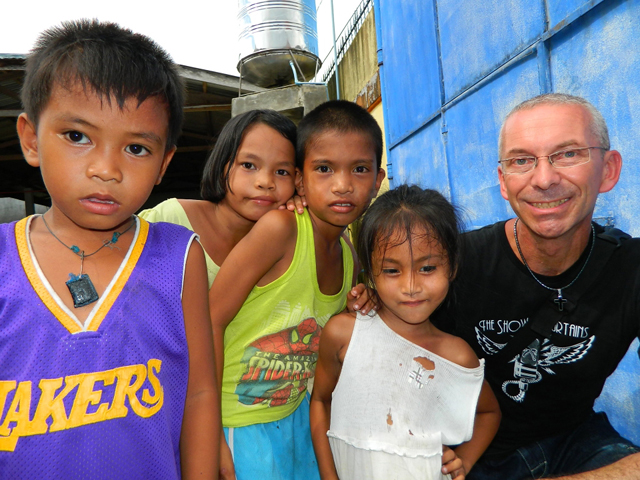 Holger 'Steve' Bergner with school children in Palo near Tacloban City.