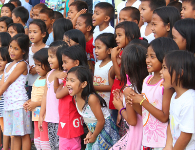 Enthusiastic Filipino children after the prayer.